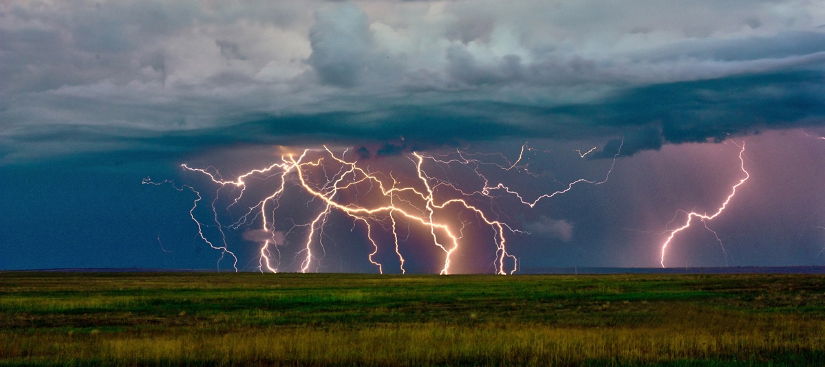 High enough difference in voltage (electrical breakdown voltage in air) produces an electrical discharge we commonly recognise as lightening.